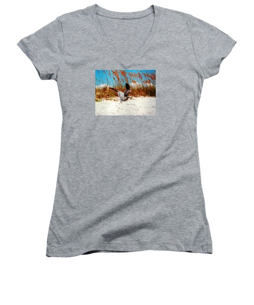 Women's V-Neck T-Shirt (Junior Cut) featuring the photograph Windy Seagull Landing by Belinda Lee