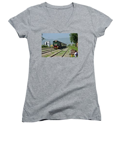 Women's V-Neck T-Shirt (Junior Cut) featuring the photograph Diesel Electric Locomotive Speeds Past Student by Imran Ahmed