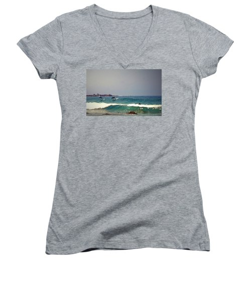 Dolphins Swimming With The Surfers At Asilomar State Beach  Women's V-Neck T-Shirt (Junior Cut) by Joyce Dickens