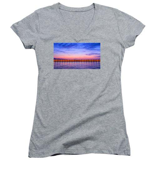 Women's V-Neck T-Shirt (Junior Cut) featuring the photograph Malaga Pink And Blue Sunrise  by Debra Martz