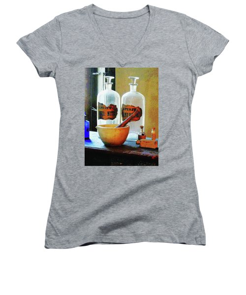 Women's V-Neck T-Shirt (Junior Cut) featuring the photograph Pharmacist - Mortar And Pestle With Bottles by Susan Savad