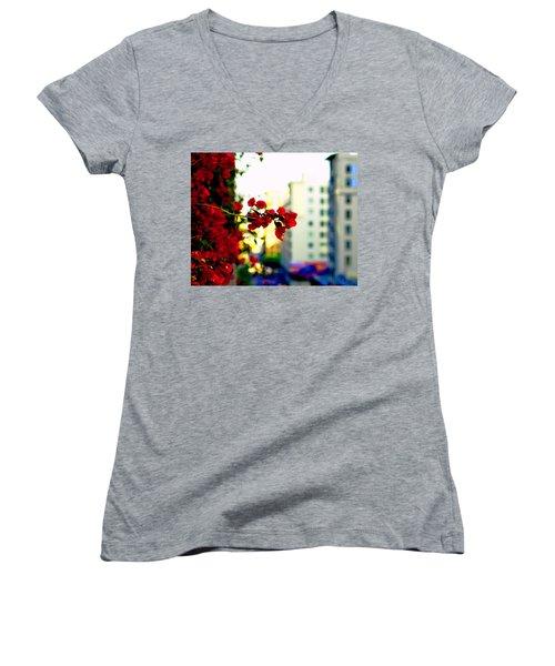 Women's V-Neck T-Shirt (Junior Cut) featuring the photograph Red Flowers Downtown by Matt Harang
