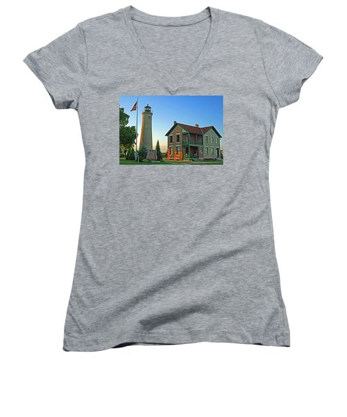 Women's V-Neck T-Shirt (Junior Cut) featuring the photograph Southport Lighthouse On Simmons Island by Kay Novy