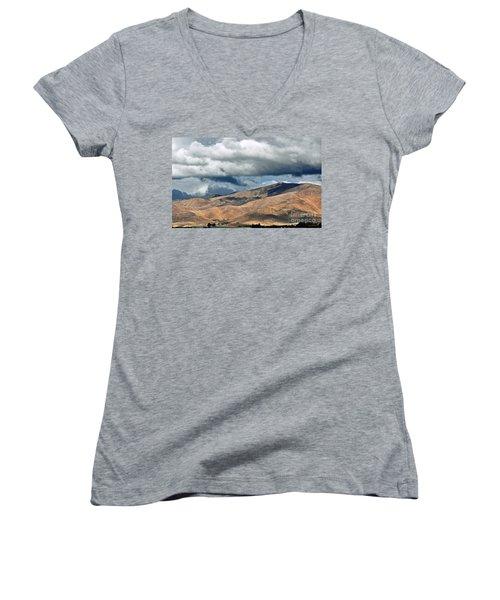 Storm Clouds Floating Above Mountains Women's V-Neck T-Shirt (Junior Cut) by Susan Wiedmann