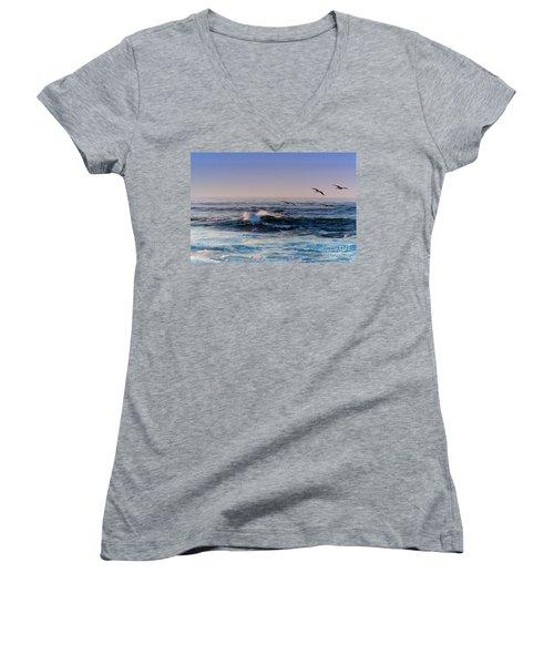 Women's V-Neck T-Shirt (Junior Cut) featuring the photograph Sunset Fly by Kathy Bassett