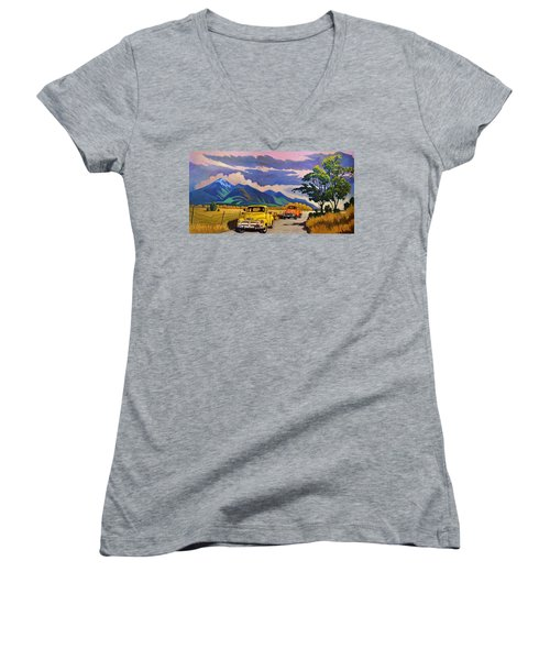 Women's V-Neck T-Shirt (Junior Cut) featuring the painting Taos Joy Ride With Yellow And Orange Trucks by Art West