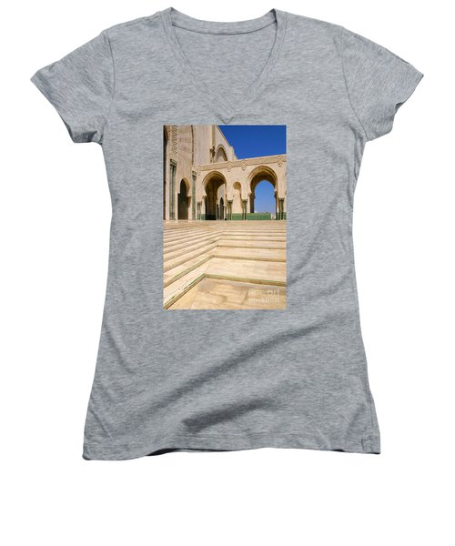 Women's V-Neck T-Shirt (Junior Cut) featuring the photograph The Massive Colonnades Leading To The Hassan II Mosque Sour Jdid Casablanca Morocco by Ralph A  Ledergerber-Photography
