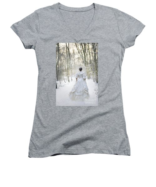 Victorian Woman Running Through A Winter Woodland With Fallen Sn Women's V-Neck T-Shirt (Junior Cut) by Lee Avison