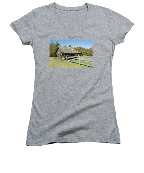 Women's V-Neck T-Shirt (Junior Cut) featuring the photograph Wooden Barn by Charles Beeler