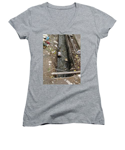 A Dirty Drain With Filth All Around It Representing A Health Risk Women's V-Neck T-Shirt (Junior Cut) by Ashish Agarwal