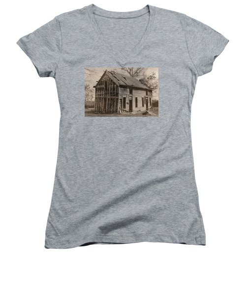 Battered And Leaning Women's V-Neck T-Shirt (Junior Cut) by Betty Northcutt