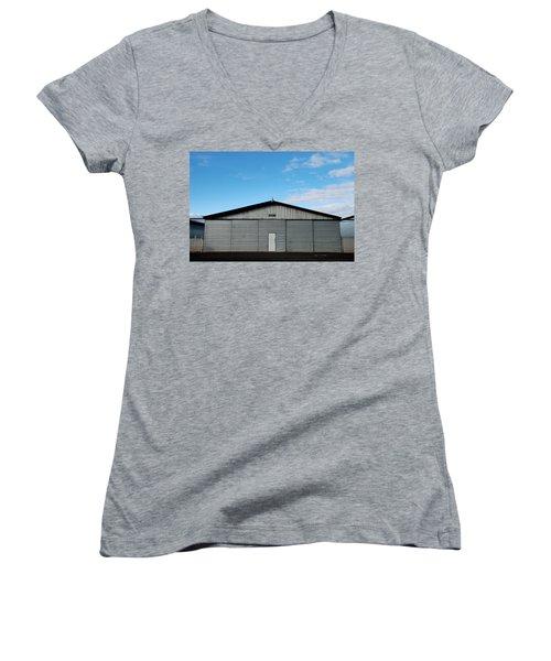Women's V-Neck T-Shirt (Junior Cut) featuring the photograph Hangar 2 The Building by Kathleen Grace