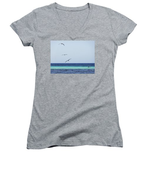 Pelicans In Flight Over Turquoise Blue Water.  Women's V-Neck T-Shirt