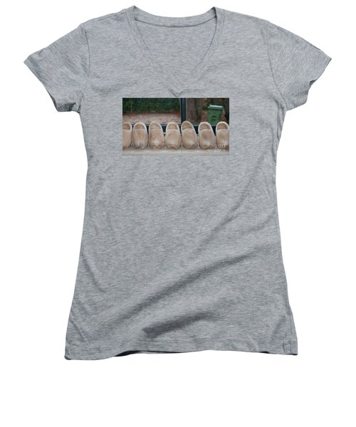 Women's V-Neck T-Shirt (Junior Cut) featuring the digital art Rows Of Wooden Shoes by Carol Ailles