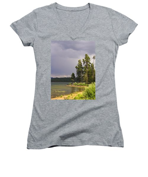 Women's V-Neck T-Shirt (Junior Cut) featuring the photograph Storm Clouds Over A Lake by Anne Mott