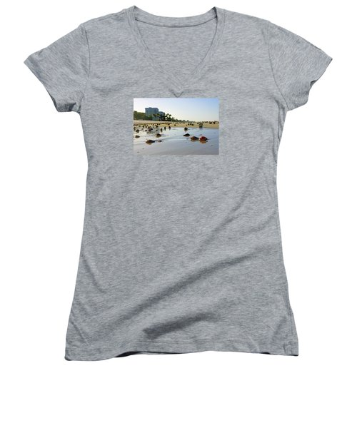 Women's V-Neck T-Shirt (Junior Cut) featuring the photograph Fighting Conchs On The Beach In Naples, Fl by Robb Stan