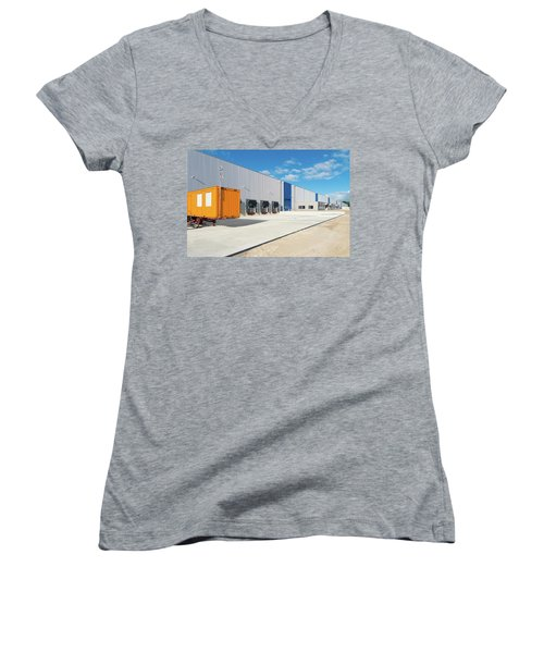 Women's V-Neck T-Shirt (Junior Cut) featuring the photograph Warehouse Exterior by Hans Engbers