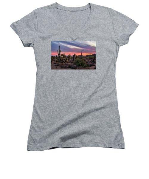 Women's V-Neck T-Shirt featuring the photograph A Pink Kissed Desert Sunset  by Saija Lehtonen