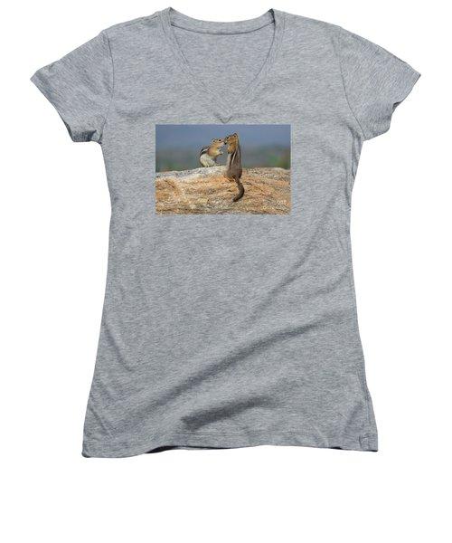 A Quick Kiss Women's V-Neck T-Shirt (Junior Cut) by John Roberts