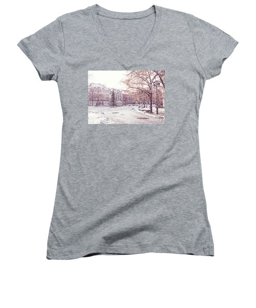 Women's V-Neck T-Shirt (Junior Cut) featuring the photograph A Street In Warsaw, Poland On A Snowy Day by Juli Scalzi