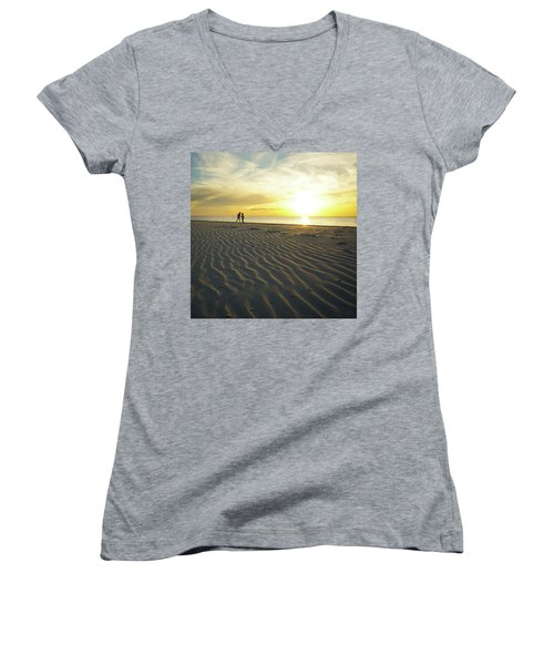 Beach Silhouettes And Sand Ripples At Sunset Women's V-Neck