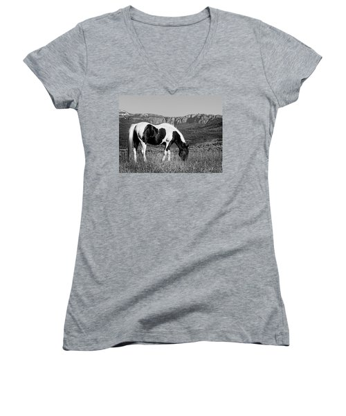 Black And White Horse Grazing In Wyoming In Black And White  Women's V-Neck