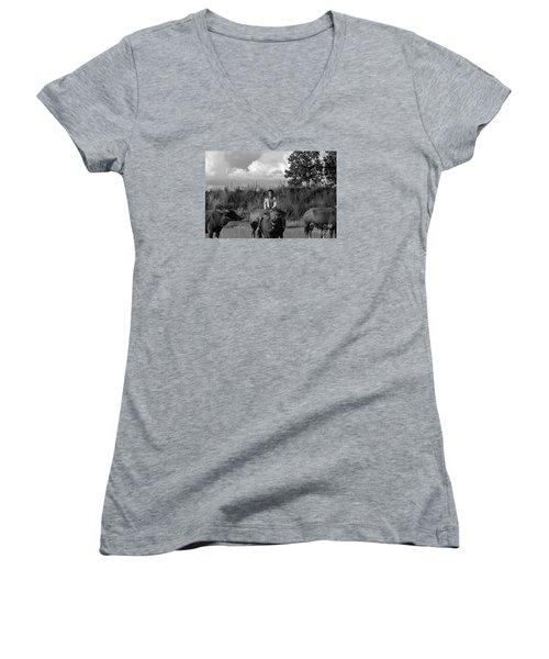 Women's V-Neck T-Shirt (Junior Cut) featuring the photograph Boy And Cows by Arik S Mintorogo