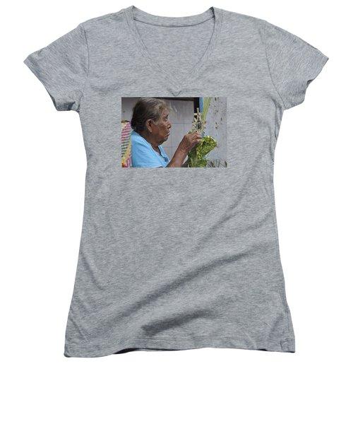 Women's V-Neck T-Shirt (Junior Cut) featuring the photograph Busy Hands by Jim Walls PhotoArtist
