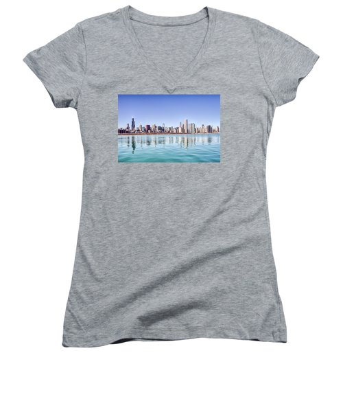Women's V-Neck T-Shirt (Junior Cut) featuring the photograph Chicago Skyline Reflecting In Lake Michigan by Peter Ciro