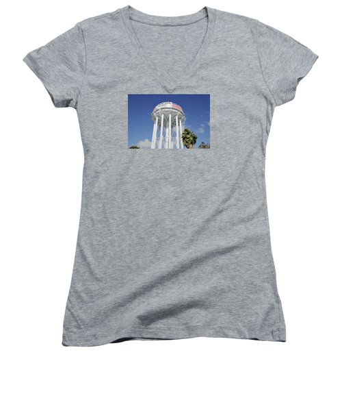 Women's V-Neck T-Shirt (Junior Cut) featuring the photograph Cocoa Water Tower With American Flag by Bradford Martin
