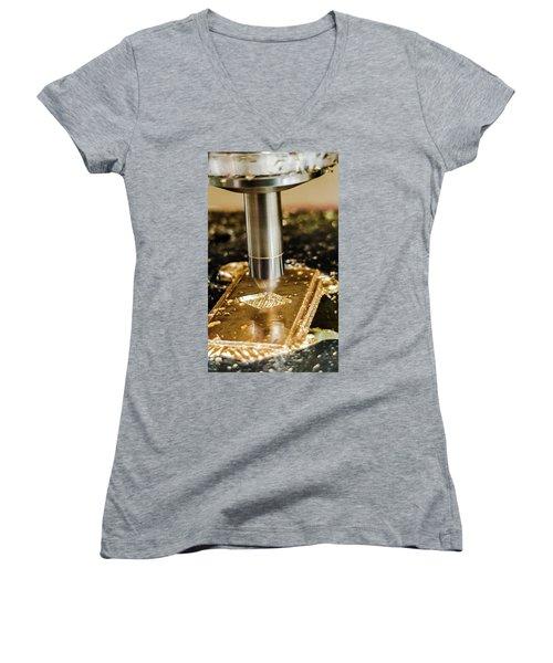 Cutting Brass Women's V-Neck T-Shirt (Junior Cut) by Bruce Carpenter