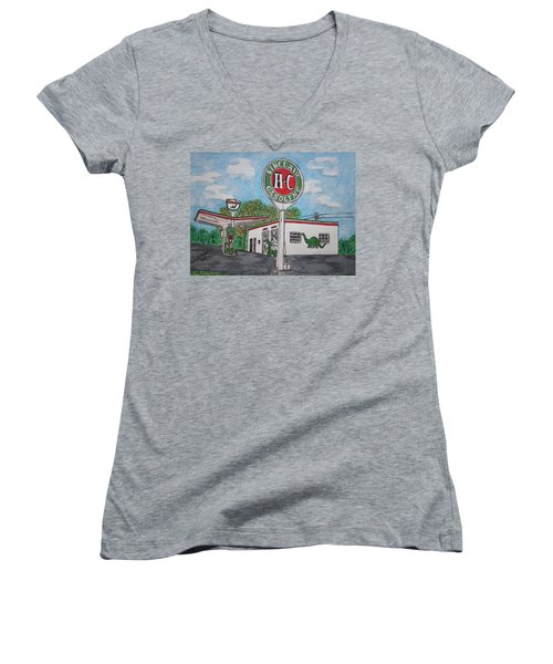 Dino Sinclair Gas Station Women's V-Neck T-Shirt (Junior Cut) by Kathy Marrs Chandler