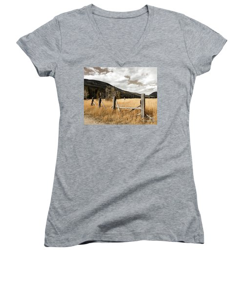 Women's V-Neck T-Shirt (Junior Cut) featuring the photograph Fallowfield Weathered Fence Rocky Mountain National Park Dramatic Sky by John Stephens