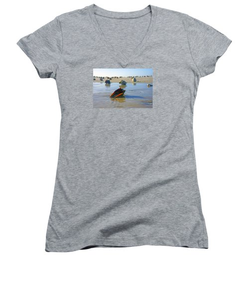Women's V-Neck T-Shirt (Junior Cut) featuring the photograph Fighting Conchs On The Sandbar by Robb Stan