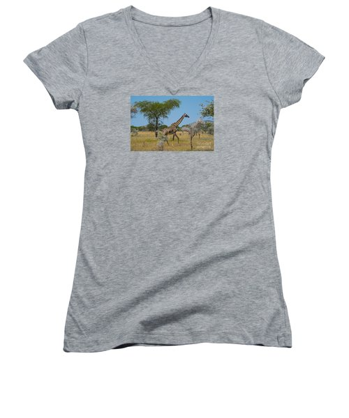 Women's V-Neck T-Shirt (Junior Cut) featuring the photograph Giraffe On The Move by Pravine Chester