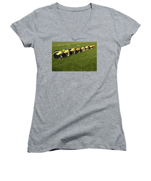 Helmets Of Different Eras On The Field Women's V-Neck (Athletic Fit)