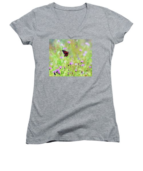Women's V-Neck T-Shirt featuring the photograph Monarch Butterfly In Flight Over The Wildflowers by Kerri Farley
