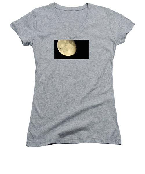 Women's V-Neck T-Shirt (Junior Cut) featuring the photograph Moon And Plane Over Sanibel by Melinda Saminski