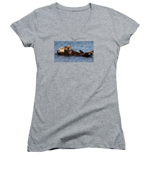 Women's V-Neck T-Shirt (Junior Cut) featuring the photograph Mother Sea Otter Cuddling Baby by Max Allen