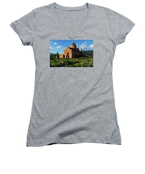Odzun Church And Puffy Clouds At Evening, Armenia Women's V-Neck T-Shirt (Junior Cut) by Gurgen Bakhshetsyan