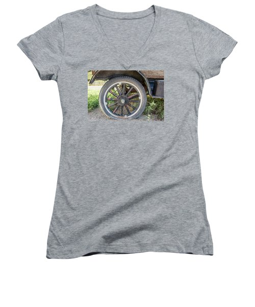 Women's V-Neck T-Shirt (Junior Cut) featuring the photograph Old Truck Tire In Rural Rocky Mountain Town by Peter Ciro