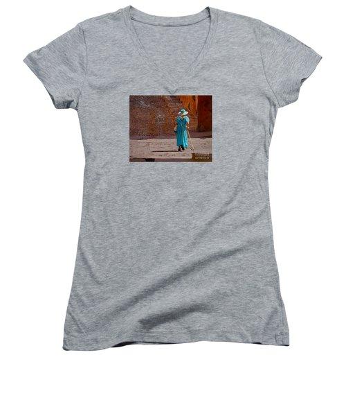 Women's V-Neck T-Shirt (Junior Cut) featuring the photograph A Woman Walking Home by John  Kolenberg