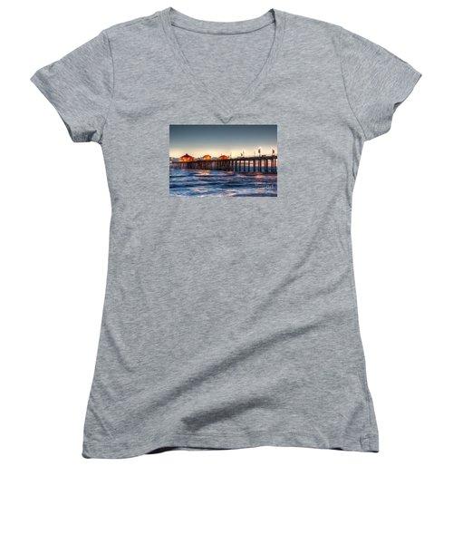 Ruby's Surf City Diner At Twilight - Huntington Beach Pier Women's V-Neck T-Shirt (Junior Cut) by Jim Carrell