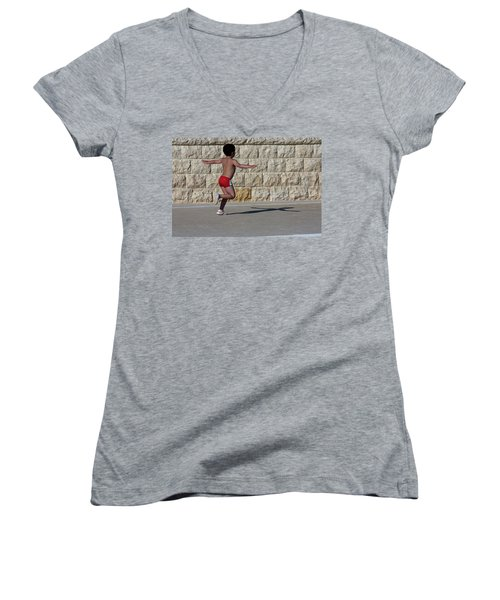 Women's V-Neck T-Shirt (Junior Cut) featuring the photograph Running Child by Bruno Spagnolo