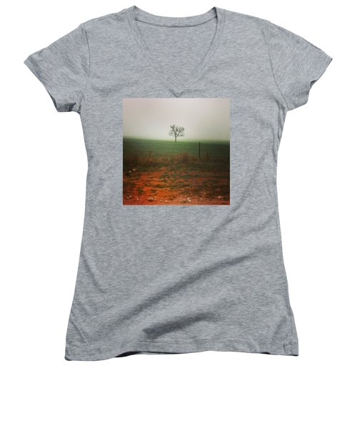 Women's V-Neck featuring the photograph Standing Alone, A Lone Tree In The Fog. by Shelli Fitzpatrick