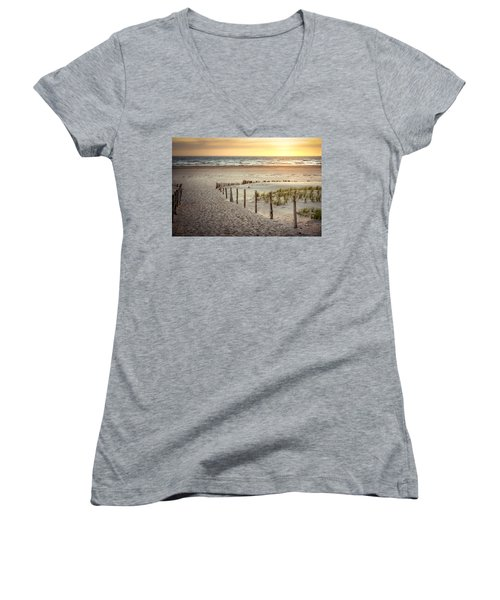 Women's V-Neck T-Shirt (Junior Cut) featuring the photograph Sunset At The Beach by Hannes Cmarits