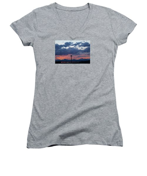 Sunset Red Clouds And Space Needle Women's V-Neck T-Shirt (Junior Cut) by Suzanne Lorenz