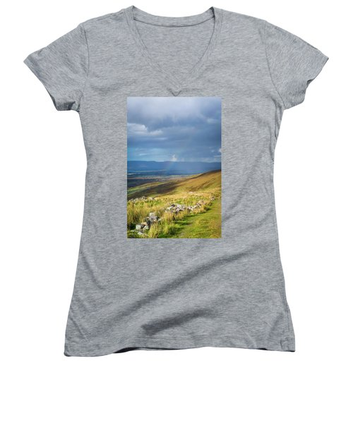 Women's V-Neck T-Shirt (Junior Cut) featuring the photograph Sunshine And Raining Down With Rainbow On The Countryside In Ire by Semmick Photo