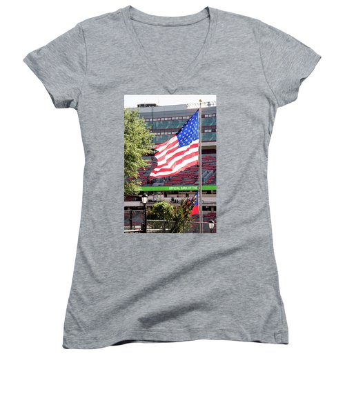 Women's V-Neck T-Shirt (Junior Cut) featuring the photograph The Flag Flying High Over Sanford Stadium by Parker Cunningham