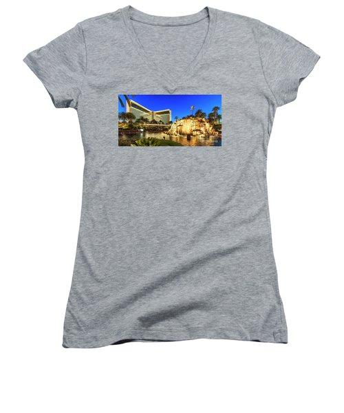 The Mirage Casino And Volcano At Dusk Women's V-Neck T-Shirt (Junior Cut) by Aloha Art